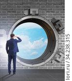 Businessman looking into future with optimism. Стоковое фото, фотограф Elnur / Фотобанк Лори