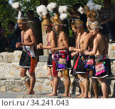 Yami tribal dancers performing at the Formosa Aboriginal Culture Village, Sun Moon Lake, Taiwan. (2010 год). Редакционное фото, фотограф Philip Game / age Fotostock / Фотобанк Лори