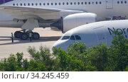 Купить «NordWind Airbus A330 preparing for departure», видеоролик № 34245459, снято 27 ноября 2019 г. (c) Игорь Жоров / Фотобанк Лори