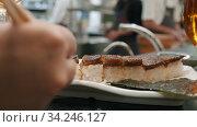 Having dinner in Japanese restaurant. Стоковое видео, видеограф Данил Руденко / Фотобанк Лори