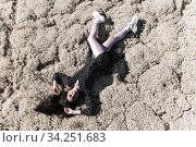 Woman laying on a dry moss. Стоковое фото, фотограф Art Konovalov / Фотобанк Лори
