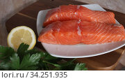 Closeup of fresh raw salmon fillet as natural food background. Стоковое видео, видеограф Яков Филимонов / Фотобанк Лори