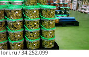 Купить «Large assortment of pickled olives in plastic buckets and jars stacked on pallets on artisanal pickles factory», видеоролик № 34252099, снято 4 августа 2020 г. (c) Яков Филимонов / Фотобанк Лори
