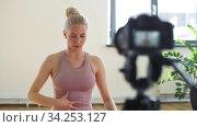 Купить «woman or blogger recording gym yoga class video», видеоролик № 34253127, снято 20 июня 2020 г. (c) Syda Productions / Фотобанк Лори