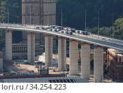 Купить «View of trucks driving over the new Genoa Bridge as part of a static test to examine the robustness of the structure ,Genoa,ITALY-19-07-2020.», фото № 34254223, снято 19 июля 2020 г. (c) age Fotostock / Фотобанк Лори