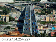Купить «View of trucks driving over the new Genoa Bridge as part of a static test to examine the robustness of the structure ,Genoa,ITALY-19-07-2020.», фото № 34254227, снято 19 июля 2020 г. (c) age Fotostock / Фотобанк Лори