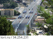 Купить «View of trucks driving over the new Genoa Bridge as part of a static test to examine the robustness of the structure ,Genoa,ITALY-19-07-2020.», фото № 34254231, снято 19 июля 2020 г. (c) age Fotostock / Фотобанк Лори