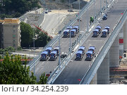 Купить «View of trucks driving over the new Genoa Bridge as part of a static test to examine the robustness of the structure ,Genoa,ITALY-19-07-2020.», фото № 34254239, снято 19 июля 2020 г. (c) age Fotostock / Фотобанк Лори
