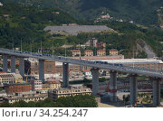 Купить «View of trucks driving over the new Genoa Bridge as part of a static test to examine the robustness of the structure ,Genoa,ITALY-19-07-2020.», фото № 34254247, снято 19 июля 2020 г. (c) age Fotostock / Фотобанк Лори
