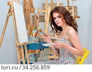 Art school, creativity, woman with easel, palette and brush painting at studio. Стоковое фото, фотограф Zoonar.com/© Dmitry Raikin / easy Fotostock / Фотобанк Лори