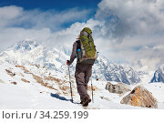 Купить «Climber in the Himalayan mountains on Everest background», фото № 34259199, снято 6 августа 2020 г. (c) easy Fotostock / Фотобанк Лори