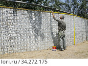 Wall of Azeri number plates as trophies in Nagorno Karabakh. After the war with Azerbadjan. Photo: André Maslennikov (2006 год). Редакционное фото, фотограф Andre Maslennikov / age Fotostock / Фотобанк Лори
