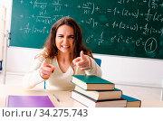 Купить «Young female math teacher in front of chalkboard», фото № 34275743, снято 5 августа 2020 г. (c) easy Fotostock / Фотобанк Лори