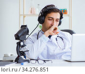 Male doctor listening to patient during telemedicine session. Стоковое фото, фотограф Elnur / Фотобанк Лори