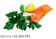 Appetizing raw salmon fillet with lemon and greens. Стоковое фото, фотограф Яков Филимонов / Фотобанк Лори