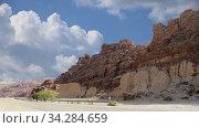 Купить «Rocks Wadi Mujib against the background of moving clouds -- national park located in area of Dead sea, Jordan», видеоролик № 34284659, снято 3 августа 2020 г. (c) Владимир Журавлев / Фотобанк Лори