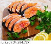 Image of raw salmon steaks with lemon and greens. Стоковое фото, фотограф Яков Филимонов / Фотобанк Лори