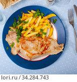 Купить «Appetizing fried pork with potatoes and herbs», фото № 34284743, снято 2 августа 2020 г. (c) Яков Филимонов / Фотобанк Лори