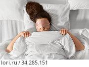 Купить «woman with eye sleeping mask in bed under blanket», фото № 34285151, снято 22 января 2020 г. (c) Syda Productions / Фотобанк Лори
