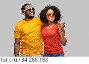 happy african american couple in sunglasses. Стоковое фото, фотограф Syda Productions / Фотобанк Лори