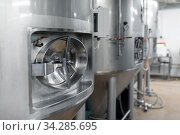 kettles at craft brewery or beer plant. Стоковое фото, фотограф Syda Productions / Фотобанк Лори