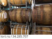 wooden barrels at craft brewery or winery. Стоковое фото, фотограф Syda Productions / Фотобанк Лори