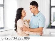 happy couple hugging at home. Стоковое фото, фотограф Syda Productions / Фотобанк Лори