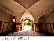 Graz, Austria 02.10.2019: View at Eggenberg palace entrance tourist spot, famous travel destination in Styria. Стоковое фото, фотограф Zoonar.com/Przemyslaw Iciak / easy Fotostock / Фотобанк Лори