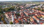 Scenic view from drone of historic center of small Czech town of Pisek on banks of Otava. Стоковое видео, видеограф Яков Филимонов / Фотобанк Лори