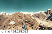 Купить «360 VR Gokyo Ri mountain top. Tibetan prayer Buddhist flag. Wild Himalayas high altitude nature and mount valley. Rocky slopes covered with ice. Panorama movement», видеоролик № 34298083, снято 28 мая 2020 г. (c) Александр Маркин / Фотобанк Лори