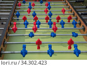 Table football in the entertainment center. Close-up image of plastic players in a football game. Стоковое фото, фотограф Zoonar.com/Alexander Strela / easy Fotostock / Фотобанк Лори