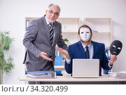 Old boss and young male employee wearing masks. Стоковое фото, фотограф Elnur / Фотобанк Лори