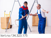 Two contractors and snake indoors. Стоковое фото, фотограф Elnur / Фотобанк Лори