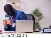 Male employee with mask in hipocrisy concept. Стоковое фото, фотограф Elnur / Фотобанк Лори