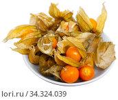 Orange physalis fruit isoalted on white. Стоковое фото, фотограф Яков Филимонов / Фотобанк Лори