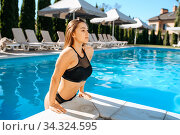 Sexy woman gets out of the water in pool outdoors. Стоковое фото, фотограф Tryapitsyn Sergiy / Фотобанк Лори