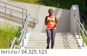 young african american woman running downstairs. Стоковое видео, видеограф Syda Productions / Фотобанк Лори
