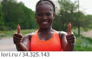 Купить «sporty african american woman showing thumbs up», видеоролик № 34325143, снято 10 июля 2020 г. (c) Syda Productions / Фотобанк Лори