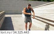 Купить «young man in headphones running outdoors», видеоролик № 34325443, снято 5 июля 2020 г. (c) Syda Productions / Фотобанк Лори