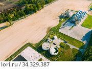 Biogas Bio-gas Plant From Pig Farm And Granary, Grain-drying Complex, Commercial Grain Or Seed Silos In Sunny Spring Rural Landscape. Corn Dryer Silos, Inland Grain Terminal, Elevators. Стоковое фото, фотограф Ryhor Bruyeu / easy Fotostock / Фотобанк Лори