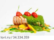 Grill roasted pork tenderloin with vegetable saute. Стоковое фото, фотограф Zoonar.com/Serghei Starus / easy Fotostock / Фотобанк Лори