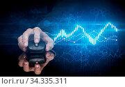 Купить «Hand using wireless mouse with statistical concept on dark background», фото № 34335311, снято 5 августа 2020 г. (c) easy Fotostock / Фотобанк Лори
