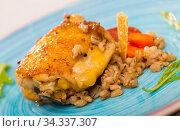 Купить «Fried chicken wings with barley porridge is tasty dish», фото № 34337307, снято 2 июля 2018 г. (c) Яков Филимонов / Фотобанк Лори