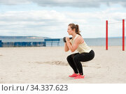 Athletic young woman during beach workout. Стоковое фото, фотограф Pavel Biryukov / Фотобанк Лори
