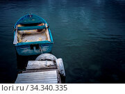 Small blue wooden rowing fisherman boat in the port and harbour in... Стоковое фото, фотограф Zoonar.com/Pawel Opaska / easy Fotostock / Фотобанк Лори