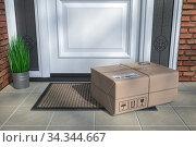 Купить «Express delivery, e-commerce online purchasing concept. Parcel box on floor near front door.», фото № 34344667, снято 6 августа 2020 г. (c) Maksym Yemelyanov / Фотобанк Лори