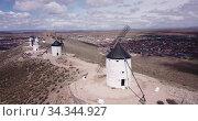 Picturesque rural landscape of Consuegra with famous windmills in sunny day, Spain. Стоковое видео, видеограф Яков Филимонов / Фотобанк Лори