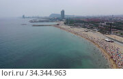 Panoramic view from the drone of coastline and beach of Barcelona. Spain (2019 год). Редакционное видео, видеограф Яков Филимонов / Фотобанк Лори