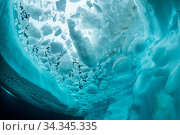 View up to sea surface between ice and iceberg. Tasiilaq, East Greenland. April. Стоковое фото, фотограф Franco  Banfi / Nature Picture Library / Фотобанк Лори