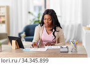 african woman working on ui design at home office. Стоковое фото, фотограф Syda Productions / Фотобанк Лори